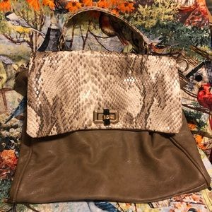 Like new!! Very cute Snake skin purse